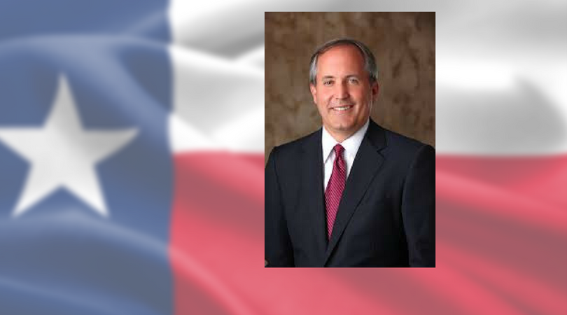 Attorney General Ken Paxton applauds lawyers defending Texas' voter ID law